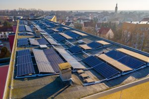 What are the challenges in deploying a solar system for a university